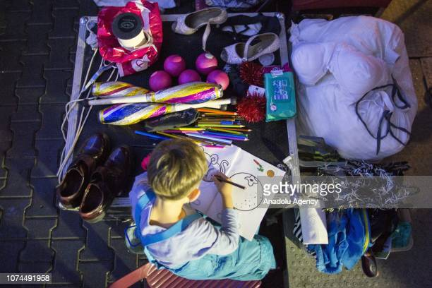 Son of Ulas and Melike Cankurt colors a coloring book in the backstage of an animal-free circus in Ankara, Turkey on December 15, 2018. Owners of an...