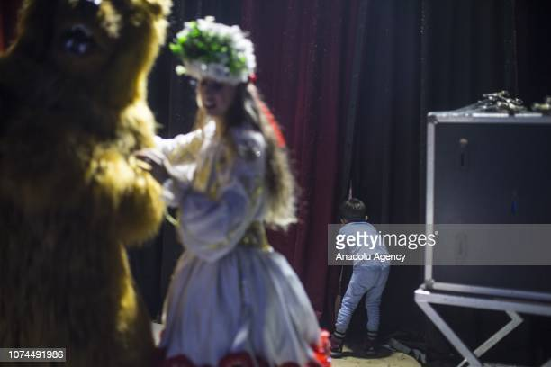 Son of Ulas and Melike Cankurt peeks through a curtain in the backstage of an animal-free circus in Ankara, Turkey on December 15, 2018. Owners of an...