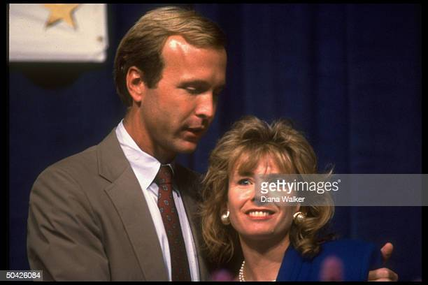 Son of US Pres Neil Bush w arm around wife Sharon