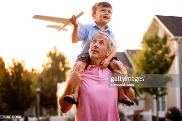 Son on Shoulders in Park