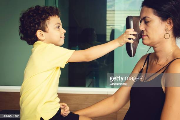 son showing his shoe to his mother - unpleasant smell stock pictures, royalty-free photos & images
