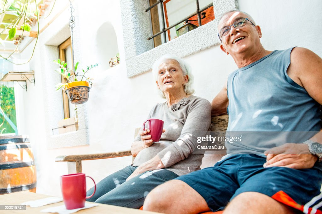 Son Taking Coffee With Her Senior Mother : Foto stock