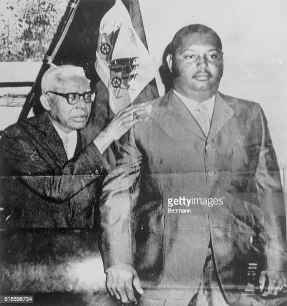 Son to be Successor PortAuPrince Haiti Presidentforlife Francois Duvalier embracing his 19yearold son Jean Claude in this poster which appeared by...
