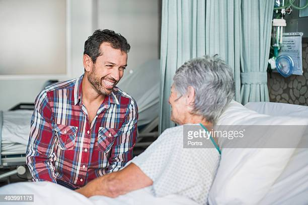 Son visiting his mother in hospital