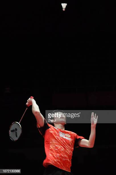 Son Wan Ho of Korea hits a shot against Shi Yuqi of China during the Men's Singles match on day 1 of the HSBC BWF World Tour Finals at Tianhe...