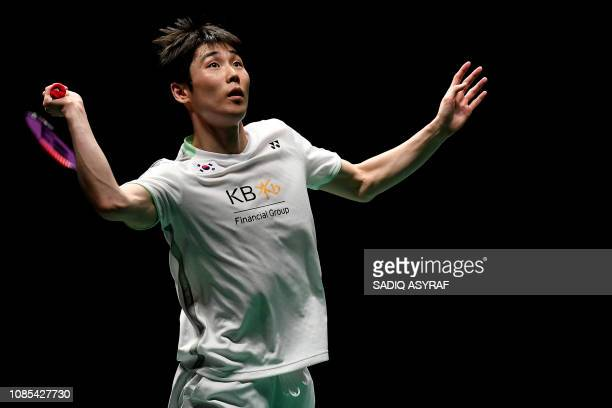 Son Wan Ho of South Korea hits a return during the men's singles final match against Chen Long of China at the Malaysia Masters badminton tournament...
