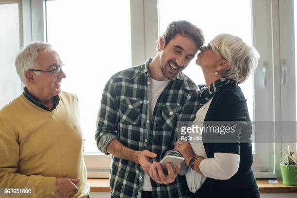 son with his parents - mother and son stock photos and pictures
