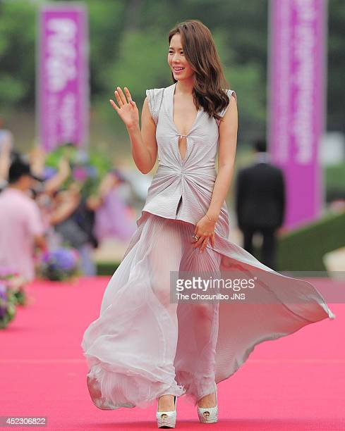 Son YeJin poses for photographs upon arrival during 18th PiFan opening ceremony at Bucheon gymnasium on July 17 2014 in Gyeonggido South Korea
