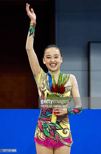 Son Yeon Jae of South Korea celebrates with her bronze medal on the podium during the medal ceremony of the rhythmic gymnastics individual allaround...