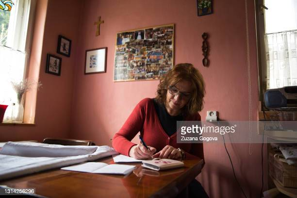 Sona Grestyova fills the health condition questionnaire other document which she needs to bring for her vaccination on April 24, 2021 in Presov,...