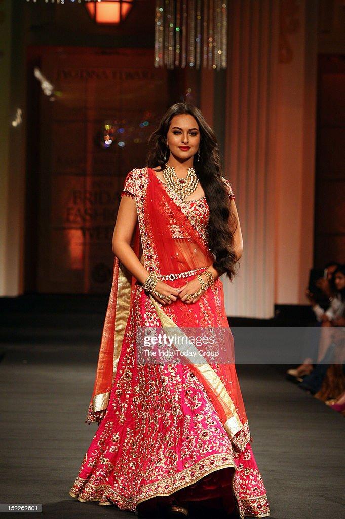 Sonakshi Sinha showcases a creation by designer Jyotsna Tiwari during the Aamby Valley India Bridal Fashion Week 2012 in Mumbai
