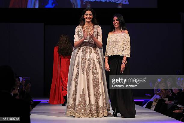Sonam Kapoor and Designer Anamika Khanna walk the runway following her show during the Indian Film Festival of Melbourne Awards Night at National...