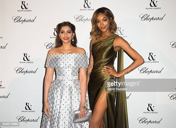 Sonam Kapoor and Jourdan Dunn attends the Ralph Russo And Chopard Host Dinner as part of Paris Fashion Week on July 4 2016 in Paris France