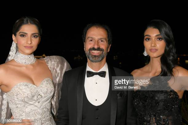Sonam Kapoor Patrizio Stella and Neelam Gill attend the Chopard Parfums 'La Nuit Des Rois' dinner party hosted by Caroline Scheufele and Patrizio...