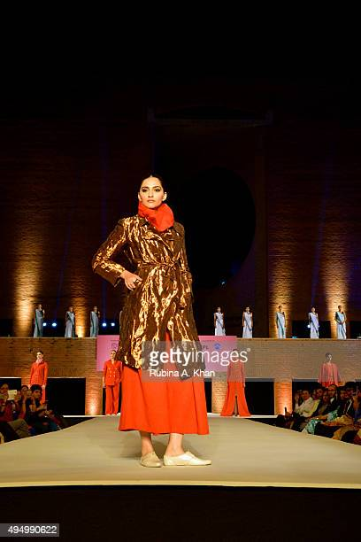 Sonam Kapoor walked the runway in khadi designerwear at the Fashion Design Council of India's Huts to High Street a fashion show organised to promote...