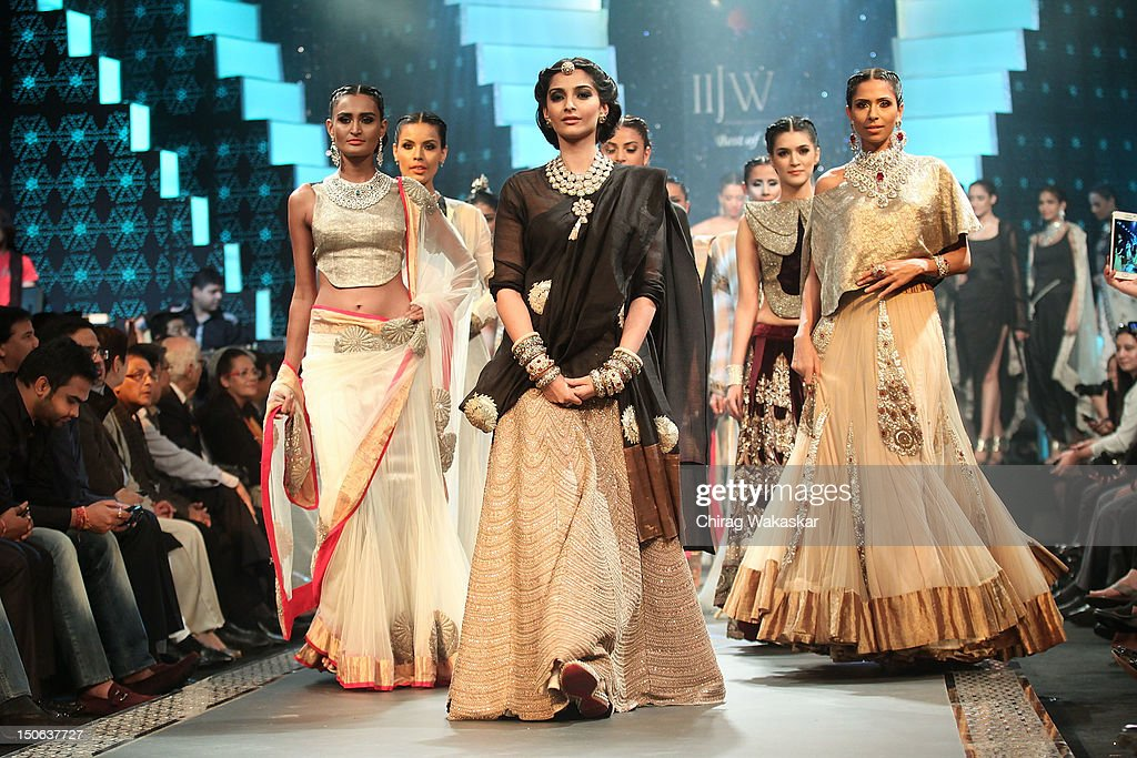 Sonam Kapoor (C) walks the runway at the PCJ Grand Finale show of India International Jewellery Week 2012 day 5 at the Grand Hyatt on August 23, 2012 in Mumbai, India.