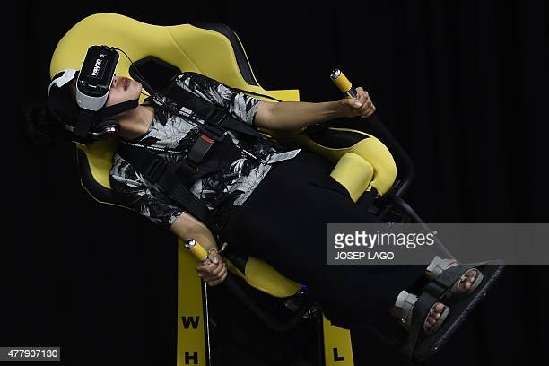 A Sonar attendee tries a VR headset during the Sonar Festival 2015 in Barcelona on June 20 2015 The Sonar music festival a rendezvous every year in...