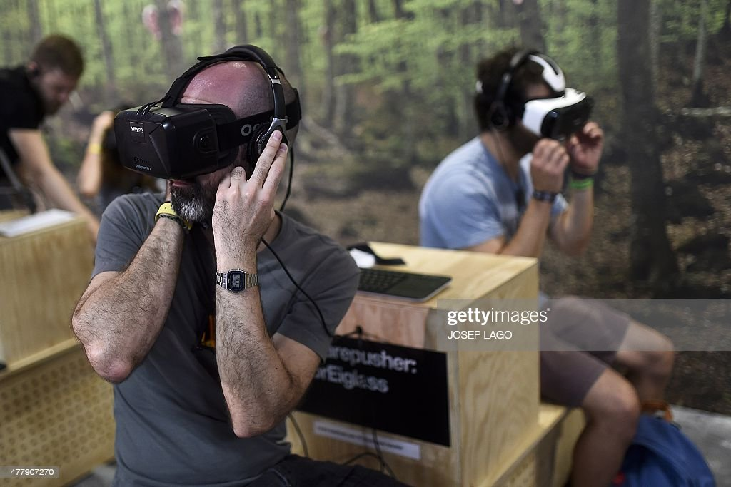Sonar attendees try VR (Virtual Reality) headsets during the Sonar Festival 2015 in Barcelona on June 20, 2015. The Sonar music festival, a rendez-vous every year in Barcelona for the most cutting-edge fans of techno and electronica, is held from June 18 to 20, 2015.