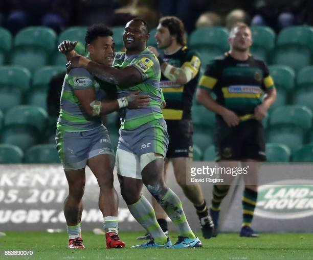 Sonatane Takulua of Newcastle celebrates with team mate Vereniki Goneva after winning the match with the last kick of the match with a conversion...