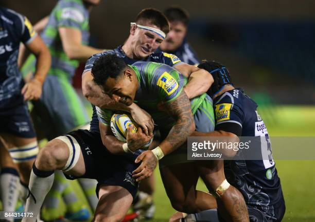 Sonatane Takulua of Newcastle Falcons is tackled by Tom Curry of Sale Sharks during the Aviva Premiership match between Sale Sharks and Newcastle...