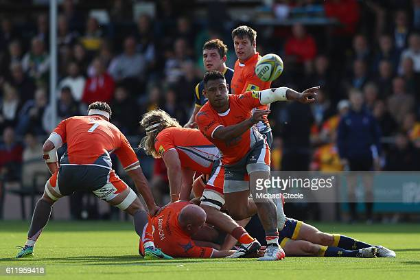 Sonatane Takulua of Newcastle feeds a ball from the scrum during the Aviva Premiership match between Worcester Warriors and Newcastle Falcons at...