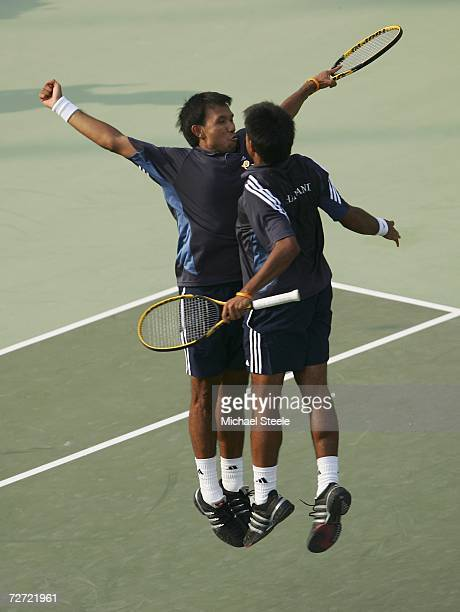 Sonchat and Sanchai Ratiwatana of Thailand celebrate victory against Denis Istomin and Murad Inoyatov of Uzbekistan during the Men's Team...