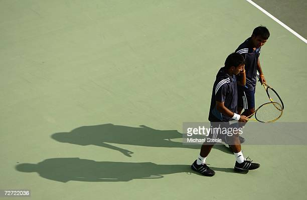 Sonchat and Sanchai Ratiwatana of Thailand discuss tactics while playing against Denis Istomin and Murad Inoyatov of Uzbekistan during the Men's Team...