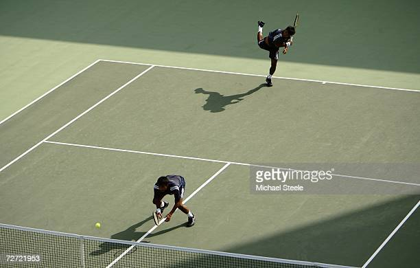 Sonchat and Sanchai Ratiwatana of Thailand in action while playing against Denis Istomin and Murad Inoyatov of Uzbekistan during the Men's Team...