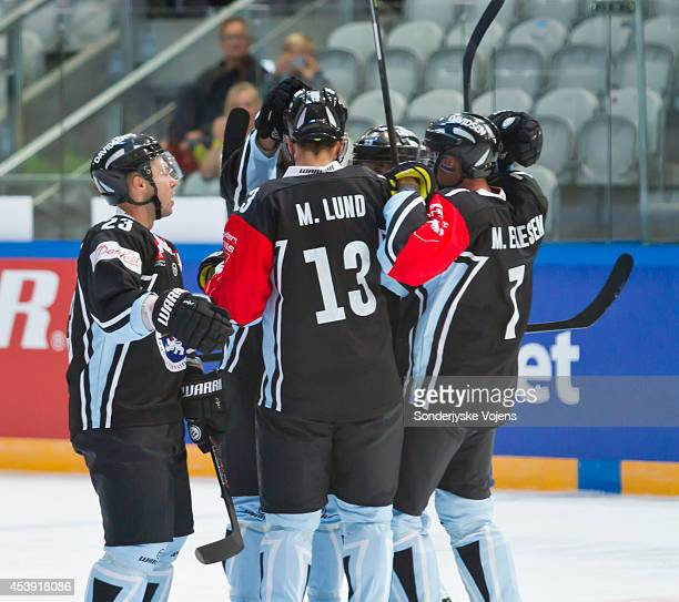 Sonderjyske Vojens players celebrate after Anders Overmark scores a goal during the Champions Hockey League group stage game between Sonderjyske...