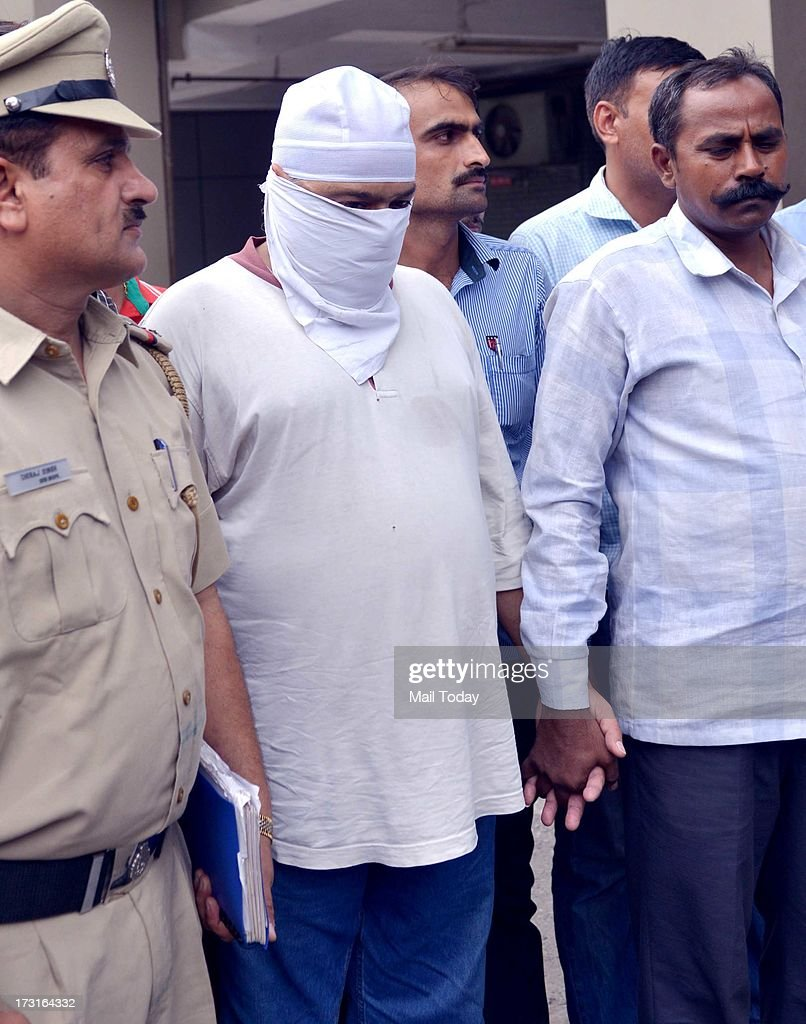 SPS Sondhi, accused of kidnapping a boy, in police custody in New Delhi on Sunday.