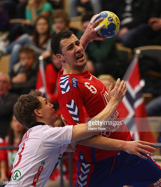 Sondre Paulsen of Norway is challenged by Marko Vujin of Serbia during the Men's Handball World Championship placement match between Norway and...