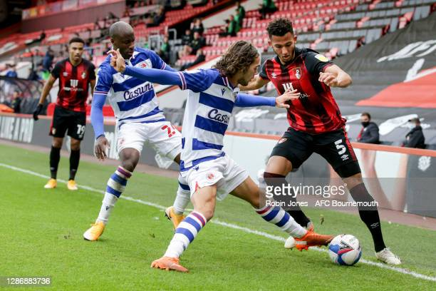 Sone Aluko and Tomas Esteves of Reading FC close down Lloyd Kelly of Bournemouth during the Sky Bet Championship match between AFC Bournemouth and...