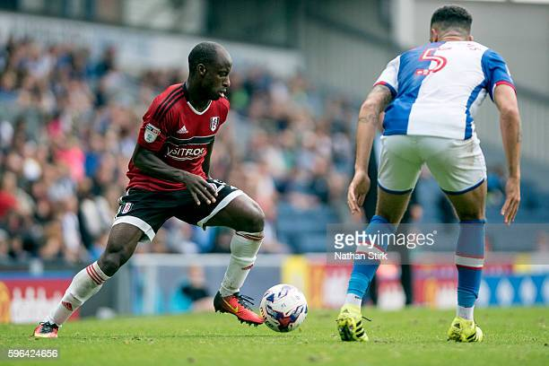 Sone Aluko of Fulham takes on Derrick Williams of Blackburn Rovers during the Sky Bet Championship match between Blackburn Rovers and Fulham at Ewood...