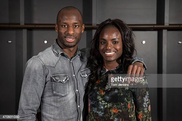 Sone Aluko of Hull City FC and his sister Eniola Aluko of Chelsea pose for a portrait in the changing rooms at Wembley Stadium on April 102014 in...