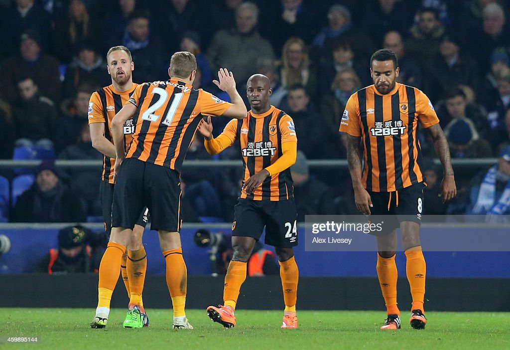 Sone Aluko #24 (C) of Hull City is congratulated by teammates after scoring a goal to level the scores at 1-1 during the Barclays Premier League match between Everton and Hull City at Goodison Park on December 3, 2014 in Liverpool, England.