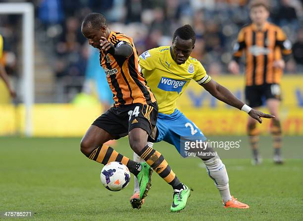 Sone Aluko of Hull City tackled by Cheick Tiote of Newcastle United during the Barclays Premier League match between Hull City and Newcastle United...