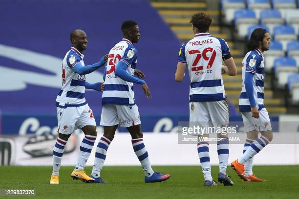 Sone Aluko of Reading and Alfa Semedo at full time of the Sky Bet Championship match between Reading and Bristol City at Madejski Stadium on November...