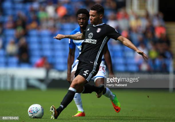 Sone Aluko of Reading and Ryan Fredericks of Fulham in action during the Sky Bet Championship match between Reading and Fulham at Madejski Stadium on...
