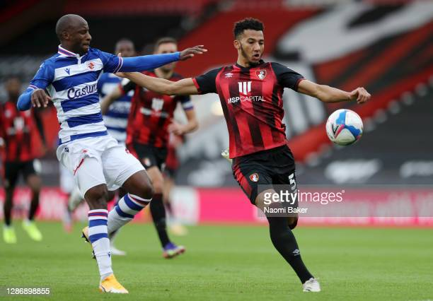 Sone Aluko of Reading FC battles for possession with Lloyd Kelly of AFC Bournemouth during the Sky Bet Championship match between AFC Bournemouth and...
