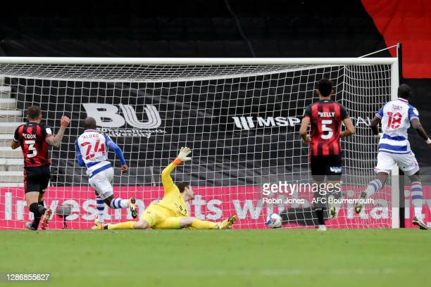 Sone Aluko of Reading FC beats Asmir Begovic of Bournemouth and scores a goal to make it 2-0 during the Sky Bet Championship match between AFC...