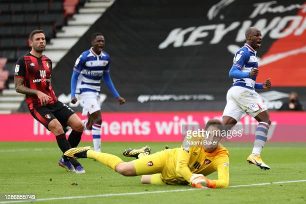 Sone Aluko of Reading FC celebrates after scoring his team's second goal as Asmir Begovic of AFC Bournemouth looks on during the Sky Bet Championship...