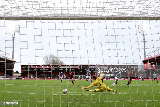 Sone Aluko of Reading FC scores his team's second goal past Asmir Begovic of AFC Bournemouth during the Sky Bet Championship match between AFC...