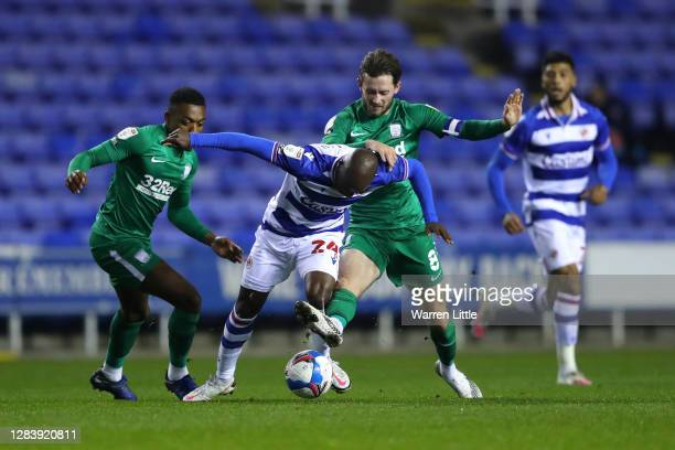 Sone Aluko of Reading is challenged by Darnell Fisher and Alan Browne of Preston North End during the Sky Bet Championship match between Reading and...