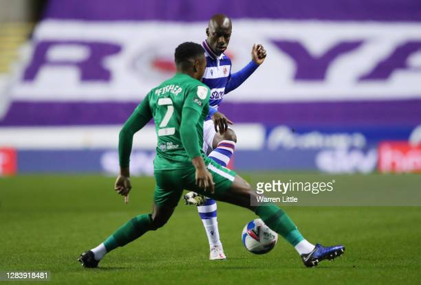 Sone Aluko of Reading is challenged by Darnell Fisher of Preston North End during the Sky Bet Championship match between Reading and Preston North...