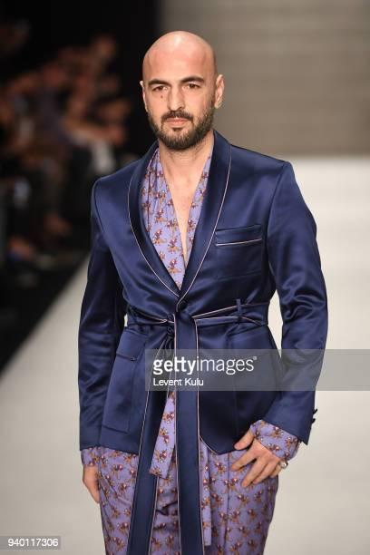 Soner Sarikabadayi walks the runway at the Emre Erdemoglu show during Mercedes Benz Fashion Week Istanbul at Zorlu Performance Hall on March 30 2018...