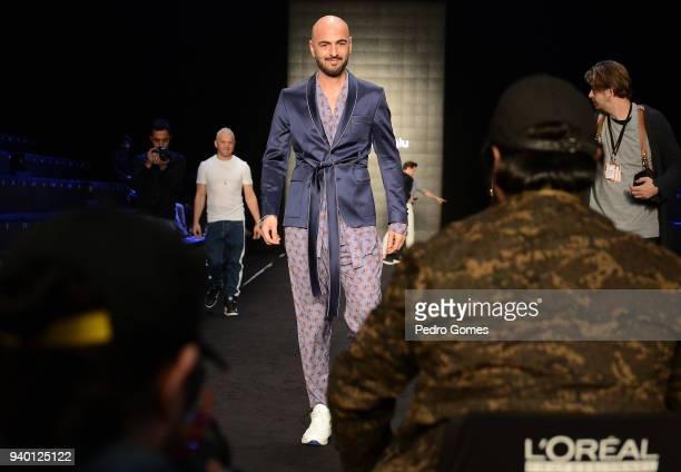 Soner Sarikabadayi walks the runway during the rehearsal ahead of the Emre Erdemoglu show during Mercedes Benz Fashion Week Istanbul at Zorlu...