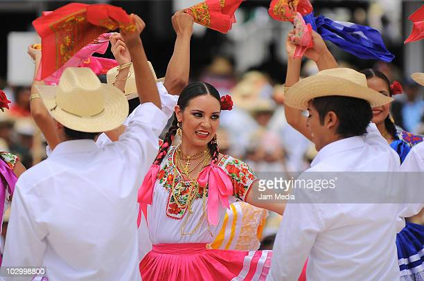 Sones and Chilenas of Pinotepa Nacional Tuxtepec perform during the Guelaguetza of Bicentenary at the Benito Juarez Stadium on July 19 2010 in Oaxaca...