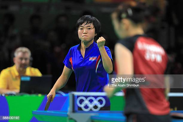 Song I Kim of North Korea celebrates a point during her Women's Table Tennis Bronze Medal match against Ai Fukuhara of Japan at Rio Centro on August...
