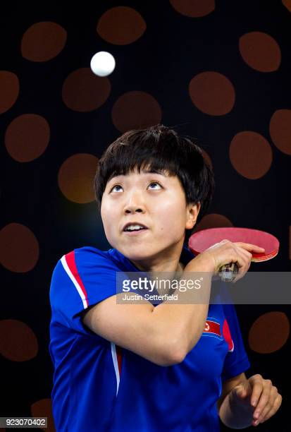 Song I Kim of People's Republic of Korea serves against Yuling Zhu of China during the ITTF Team World Cup Table Tennis at Copper Box Arena on...