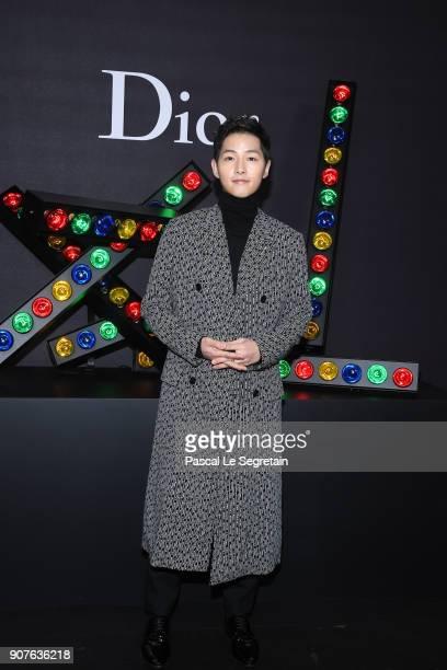 Song Joongki poses at Dior Homme Menswear Fall/Winter 20182019 show as part of Paris Fashion Week at Grand Palais on January 20 2018 in Paris France